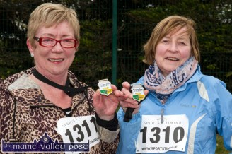 Mary O'Connor, Kilcummin (left) and Kathleen Sheehan, Firies after they finished the annual An Riocht AC / Lee Strand Kingdom Come 10 Miler and 5K Road Race in Castleisland this morning. ©Photograph: John Reidy