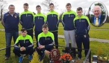 Richard O'Donoghue and some of the Minor Players who came to pay their respects to Tom Wrenn at his grave after his Month's Mind Mass on Friday evening.
