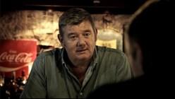 John Creedon playing the barman / referee in Pat. Screenshot by Shaun O'Connor.
