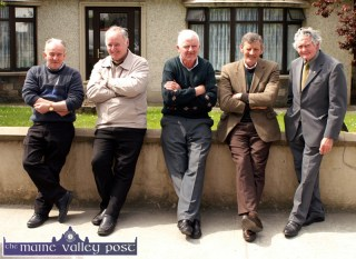 Eleven years ago to the day: The late Con O'Connor (second from right) with neighbours from left: Denis Lyons, John Buckley, Paddy O'Connor and Tom Horan at their traditional meeting place on McGaley's wall on Church Street after Sunday mass. ©Photograph: John Reidy 15/05/2005