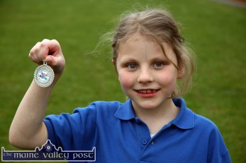 Look at that: Maria Daly is justifiably proud of her medal at the 2010 Currow / Currans Community Games finals at An Riocht AC Stadium in Castleisland. ©Photograph: John Reidy 28-5-2010