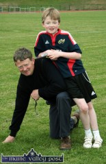 Lean on Me: Tommy Dennahy finds a strong shoulder to lean on, in dad, William, the 2010 Currow / Currans Community Games finals at An Riocht AC Stadium in Castleisland. ©Photograph: John Reidy 28-5-2010