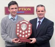 The Jim Lyons Award being presented to Ciaran Lane by Principal Denis O'Donovan .