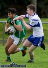 Milltown/Castlemaine corner-forward, Jonathan O'Sullivan in possession and trying to shake off the attentions of Desmonds corner-back, David Lynch during their drawn Co. League game in Castleisland on Saturday evening. ©Photograph: John Reidy