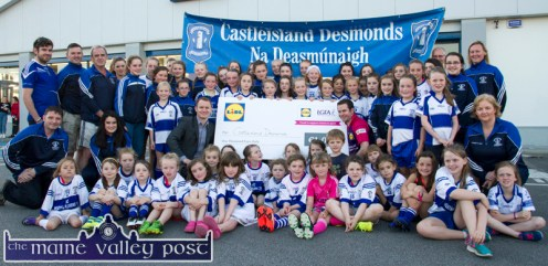 Declan Murphy, Lidl Sales Operations Manager Kerry and Martin Leen Lidl Deputy Manager are surrounded by delighted Desmonds Ladies GAA Club members and players at the €1,000 cheque presentation ceremony at the Tralee Road store on Monday evening. ©Photograph: John Reidy