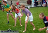 Fierce concentration on the faces of these young athletes at the start of one of the relay races during Sunday's annual Knocknagoshel Pattern Festival sports. ©Photograph: John Reidy 15-8-2004