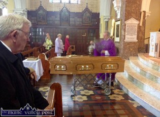 Fr. Anthony O'Sullivan conducting the funeral mass for the late Paul Malpass with Jim O'Connor (left) at the Church of Saints Stephen and John yesterday. ©Photograph: John Reidy 1-8-2016
