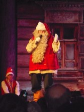 Santa himself speaking to the elves during playtime at the toy factory in Lapland.