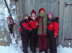 Doreen Buckley, Eileen and Christina Long pictured with one of Santa's elves during their visit to Lapland.