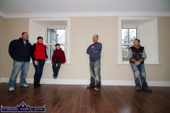 Pat, Melanie and Fionn Walsh pictured with project contractor, Seán Nolan and carpenter, John Nolan in the living room of the restored house before Christmas. ©Photograph by John Reidy.
