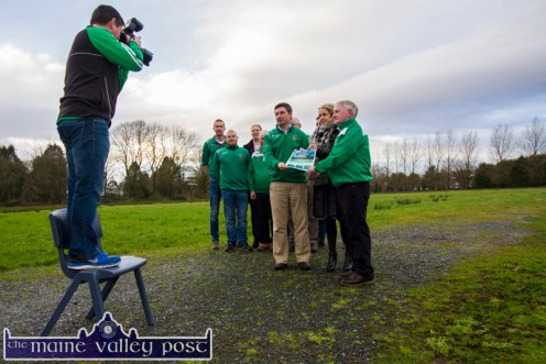 Out Standing in their Own Field: Castleisland AFC member and Kerry's Eye photographer, Mike Brosnan capturing the moment of the announcement of the collaboration between the club and Castleisland Community College to create an all weather playing pitch where they're standing. ©Photograph: John Reidy