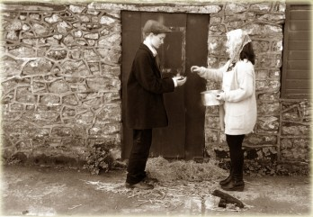 Alms for the poor: Laura O' Shea and Maire O' Connor playing their parts in the school film project on The Moonlighters.