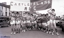 Spot Georgie: Youthful Castleisland AFC members with their coach, Georgie O'Callaghan carrying their banner in the first St. Patrick's Day Parade in Castleisland. ©Photograph: John Reidy 17-3-1989