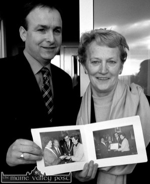 Health Minister Micheál Martin got a reminder of his days as Cork's Lord Mayor from former ICA National President, Monica Prendiville when she produced photographs of their last meeting. The minister stopped of at Castleisland's new day-care centre during a tour of North Kerry. ©Photograph: John Reidy 15/01/2002
