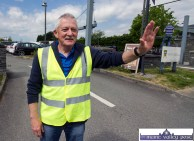 Refusal with a smile: Even the breeze found it hard to get past steward James O'Leary as he guarded the library car park gathering point for the Coiste Na nÓg 50th anniversary parade in Castleisland on Sunday. ©Photograph: John Reidy