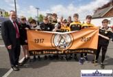 Former GAA National President, Seán Kelly, MEP with representatives of Austin Stacks GAA Club at the Coiste Na nÓg 50th anniversary parade in Castleisland on Sunday. ©Photograph: John Reidy