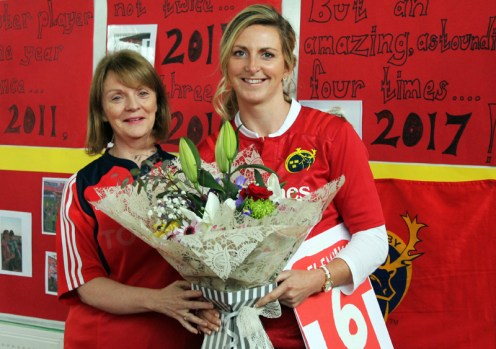Munster Rugby, four-time Player of the Year award winner, Siobhán Fleming receiving a presentation from Principal Margaret Hanifin at Scoil Mhuire agus Naomh Treasa in Currow during the reception in her honour there on Friday. Photograph: Breda McGaley.