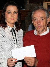 Willie Reidy, Castleisland Races Committee presenting a cheque to Bridget McMahon who accepted on behalf of Feileacáin the Stillbirth and Neonatal Death Association of Ireland at the annual cheque presentation ceremony at Tom McCarthy's Bar on Friday night. Photograph: Pat Hartnett.