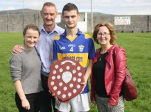 Senior team player Pádraig Brosnan and his sister, Roisin Brosnan and parents, Pat and Betsy with the trophy after Sunday's game against Asdee.