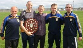 Club management from left: Domo Ó Ciardubháin, Kevin Walshe, Daniel O'Connor with players Tim O'Donoghue and Sean Óg Ó Ciardubháin.