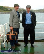 Leaving the Island: Jackie Dan Jerry O'Connor (left) with Dessie O'Halloran on the Galway Bay Ferry at Inishbofin on the way home from the second visit to the island ©Photograph: John Reidy 25/07/2004