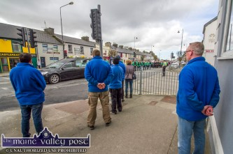 The staff of MP Moran turn out to pay their respects to the late Georgie O'Callaghan as his remains are being taken to Kilbanivane in Castleisland on Thursday aftrenoon. ©Photograph: John Reidy