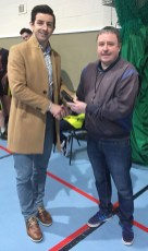 In appreciation: All-Ireland winning coach and event volunteer, Tommy Dom O'Connor receives a presentation from special guest, Garda Aidan O'Mahony at the 10th annual KDYS / Garda Good Friday Basketball Blitz at Castleisland Community Centre. Photograph: KDYS/ Garda
