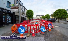 Water pipe replacement work on Castleisland's Lower Main Street has reduced the capacity to single lane traffic. ©Photograph: John Reidy