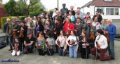 Almost there: Fiddlers getting settled as the annual photograph and tunes session gets underway at World Fiddle Day Scartaglin 2018 on Saturday afternoon. ©Photograph: John Reidy