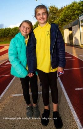 Clíona Hayes and Julie O'Connor were on medal presentation duty at the finishing line of the last of the three autumn 5K races at An Ríocht AC, Castleisland. ©Photograph: John Reidy
