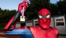 One for the web: Spiderman with his medal at the finishing line of the last of the three autumn 5K races at An Ríocht AC, Castleisland. ©Photograph: John Reidy
