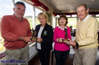 Castleisland Members' Golf Club 2018 Scramble men's winner, Willie Galvin (left) being presented with his prize by lady captain, Mary Ann Downes as ladies winner Mary Scanlon recieves her statuette from outgoing scramble organiser, Cyril Quigley at the clubhouse on Wednesday. Photo by John Reidy