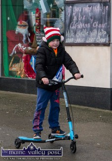 Scooting along: Seven year old, Dáithí Doyle from Listowel was the first to launch himself into the Run Rudolph Run 5K Road Race in Castleisland on Sunday. ©Photograph: John Reidy
