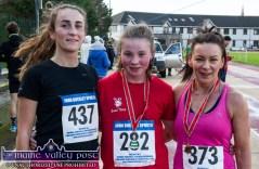 Winner, Carol Finn, Lee Vale AC (left) with: Niamh O'Mahony, 2nd and Marie McKenna after the Run Rudolph Run 5K Road Race in Castleisland on Sunday. ©Photograph: John Reidy
