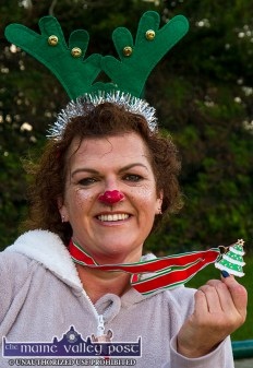 Louise Porter from Tralee pictured with her Christmas tree medal after the Run Rudolph Run 5K run at An Ríocht Athletic Club in Castleisland. ©Photograph: John Reidy