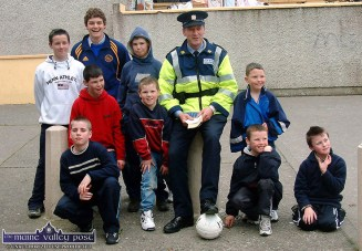 Castleisland's newly appointed, Sgt. John O'Mahony pictured on a soccer team recruitment drive in St. John's Park for his first Garda Estates Soccer League in 2003: Pictured with him on that occasion are front from left: Andrew Foran, Edward O'Brien and Emmet McCarthy. Back, from left: Stephen Bartlett, Darren Templeman, Robert, James, Marty and Michael O'Brien. Plans are well under way for this year's league which will be played at the local soccer club grounds on Limerick Road from June 25 to 30th. ©Photograph: John Reidy 2-4-2003