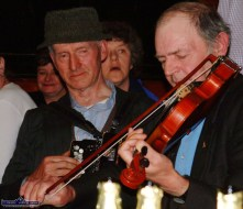 The late Jackie Dan Jerry O'Connor, Castleisland and the late Dessie O'Halloran getting down to business in Day's Bar on Inishbofin. Photograph: John Reidy 6-6-2003