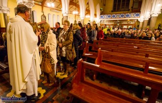 Pews emptying, queues lengthening at Castleisland PP Fr. Mossie Brick blesses the attendance with the Padre Pio healing glove the first Padre Pio, Tuesday night novena at the Church of Saints Stephen and John. ©Photograph: John Reidy