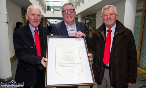 Reception proposer, Cllr. Bobby O'Connell (centre) with the Kerry County Council scroll which was presented to St. Mary's Basketball Club's Donal O'Connor (left) and Ned O'Callaghan at the civioc reception at the Castleisland Area Services Centre on Wednesday. ©Photograph: John Reidy