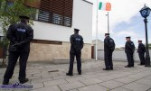 Flying at half mast but flying. Colleagues of the fallen Detective Garda Colm Horkan paying their tributes at Castleisland Garda Station. ©Photograph: John Reidy