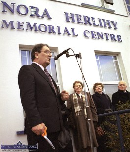 John Hume M.P. M.E.P. addresses the gathering before the official opening of the Rathmore and District Credit Union - Nora Herlihy Memorial Centre in Ballydesmond in November 2000. Looking on are the late Ms. Herlihy's sisters, Margaret Murphy, Sheila O'Carroll and her husband Tadhg O'Carroll. ©Photograph: John Reidy 27-11-2000