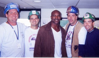 World Heavyweight Boxing Champion, Evander Holyfield pictured with work crew members including Michael Burke (right) during a high profile visit to the site after the 9/11 attacks on the World Trade Centre in September 2001.