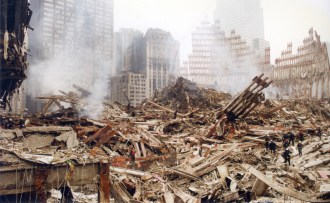 Where would you start? Workers dwarfed by the enormity of the task aheadv of them in a photograph from Michael Burke's album of the World Trade Centre site after the 9/11 attacks in September 2001.