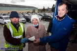 Kit Murphy, representing St. Mary of the Angels, Beaufort receiving a cheque for €3,020 for her charity from Castleisland Drive-In-Bingo organisers, Chairman Cllr. Charlie Farrelly (left) and Ronan Bourke committee member at last Sunday's session. ©Photograph: John Reidy