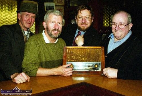 Tuning in: Pictured during the 2002 Céilí House recording at Brennan's Bar were, from left: Jackie Dan Jerry O'Connor, musician; Kieran Hanrahan, presenter; Peter Browne, producer and Sean Brennan, proprietor. The radio in the photograph belonged to the late Con Brosnan of Barrack Street. ©Photograph: John Reidy 10-11-2002