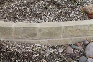Mortared stone edging, Prosper TX, chopped sand stone, landscaping river rock