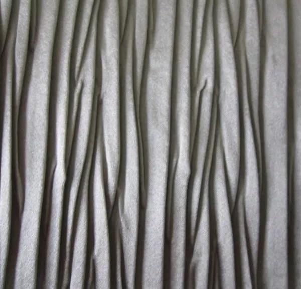 gonna plissettata, gonna plissè, plissettatura tessuto, tessuto plissettato, pelle plissettata