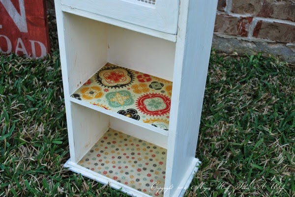 Decorate shelves with scrapbook paper and modge podge