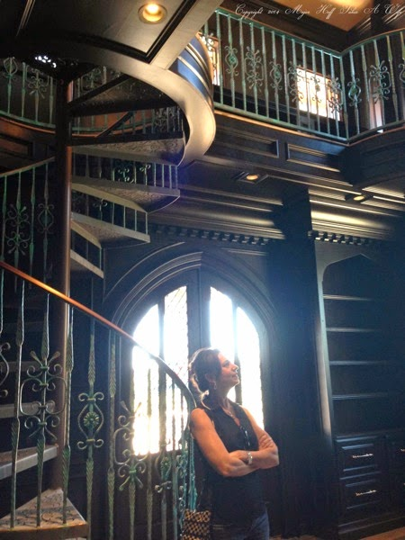 Two story library spiral staircase