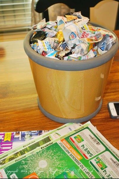 Fill pot with crumpled newspaper ads